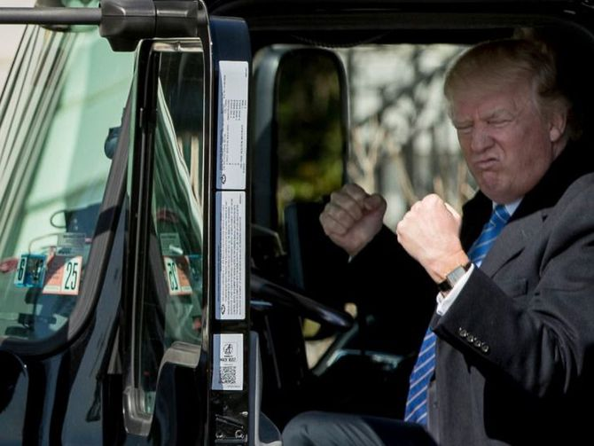 Donald Trump sits in a truck, pretends to be big man.